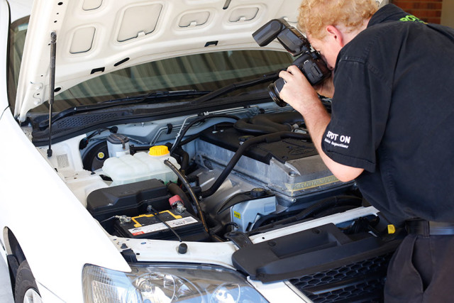 Photographing the engine as part of a vehicle inspection in Perth