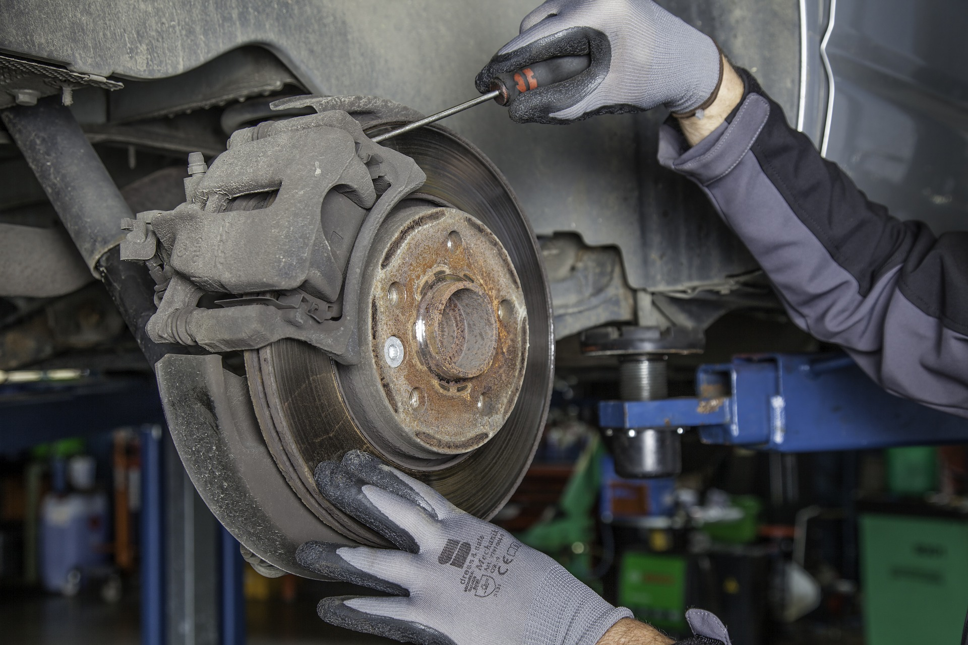 Vehicle Inspection Checking Brake Disc And Caliper In Perth